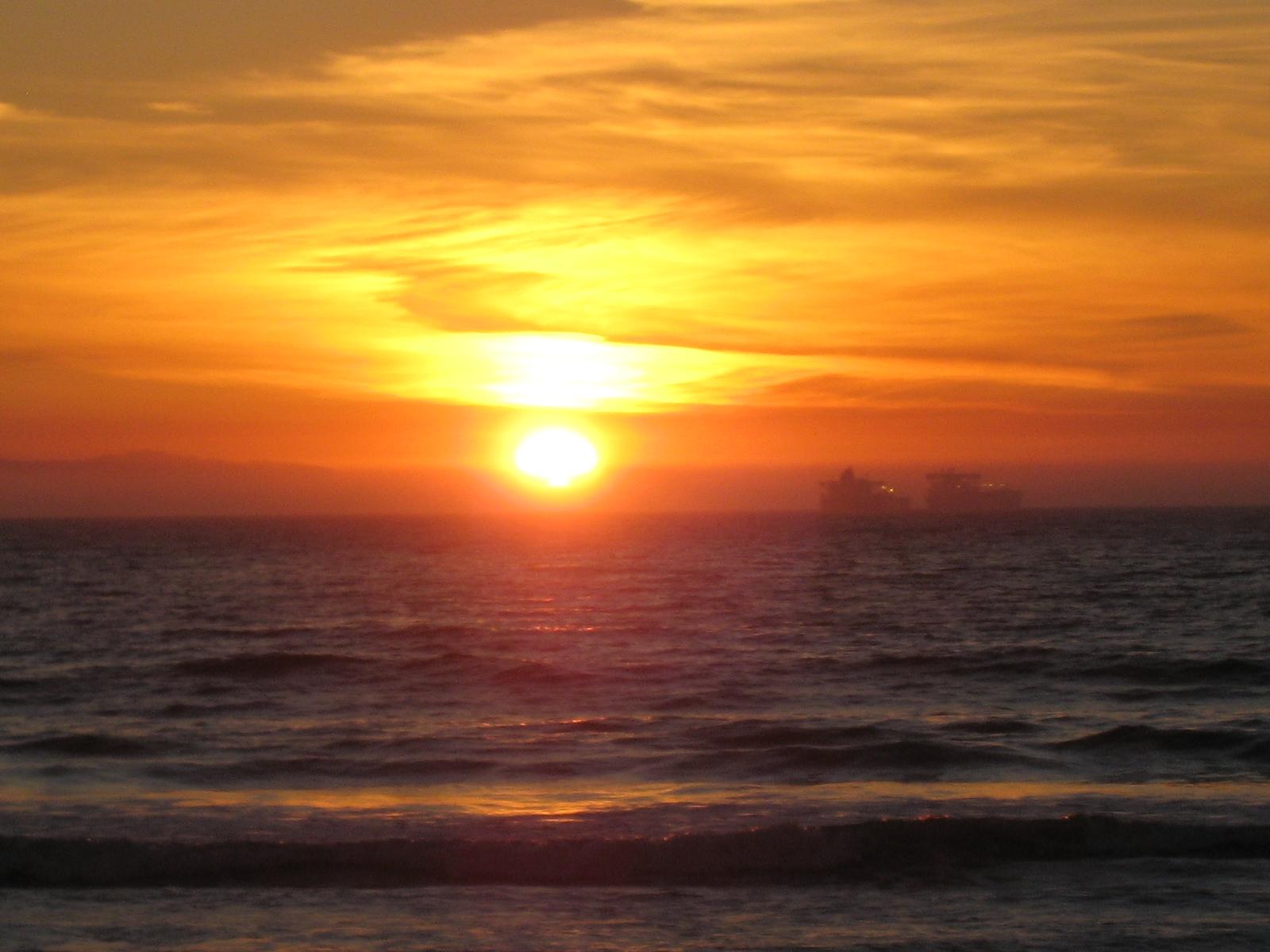 HUNTINGTON BEACH SUNSET BEACH KIDS PLAYING ON BURMS ...